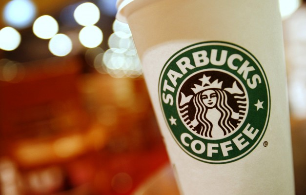 A cup of Starbucks coffee sits on a table in a cafe in central Hong Kong