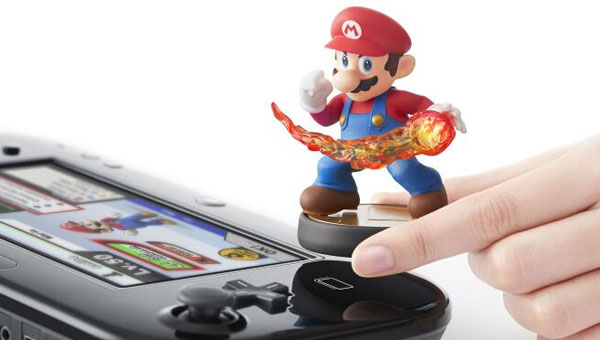 Mario, it's a go! Amiibo will allow figurines such as this to interact with a variety of Nintendo games, the first being Super Smash Bros on Wii U.